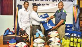 Dilroy Fernando the CEO and Director of Agoal International makes a presentation to a representative of one of the schools on behalf of the Bahrain Rugby Football Club.