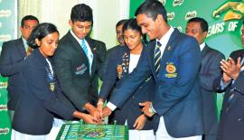 Last year's Age Group Swimming schools champion team captains Brendo Fernando (St. Joseph's College) and Minoli Kaluarachchi (Mahamaya Girls School) and the best swimmers of last year Akalanka Peiris (St. Peter's College) and Maheshi Hewage (Sirimavo Bandaranaike BMV cut a cake to celebrate to mark the 25th sponsorship anniversary of Nestle