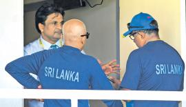 Sri Lanka manager Asanka Gurusinha (right) and coach Chandika Hathurusinghe talk to match referee Javagal Srinath