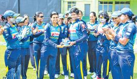 Sri Lanka women's captain Shashikala Siriwardena presents Kaveesha Dilhari (right) with her cap (Pix courtesy papare)