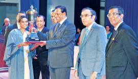 Minister Amaratunga presenting the Ceylon Hotel School Graduates Association Trophy for the Most Outstanding Graduate to B. Rengaswamy.