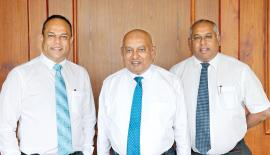 At the launch of 'Pick My Load'. From left: DIMO Director Vijitha Bandara, Chairman and Managing Director Ranjith Pandithage and Group CEO Gahanath Pandithage.