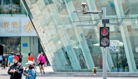 A camera used to identify drivers or pedestrians who blew through red lights is pictured in Shenzhen city, South China's Guangdong province in April 23.