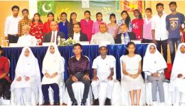 Students with the chief guest and guest of honour.