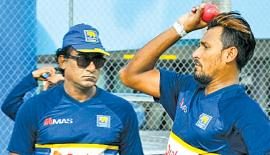 Suranga Lakmal practices with a pink ball ahead of the match