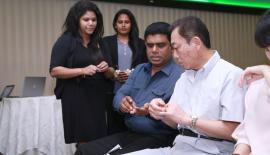 Invitees experience the Eco Balm range of products. Pic: Chaminda Niroshana