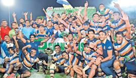 The Champion St. Peter's College team celebrate winning the inter-school Milo President's Trophy rugby tournament at the Race Course ground in Colombo yesterday. They beat St. Joseph's College 22-20 Pic: Saman Mendis