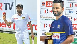 Dilruwan Perera(left) shows the ball and at right Man of the Match Dimuth Karunaratne with his trophy Pix: Saman Mendis