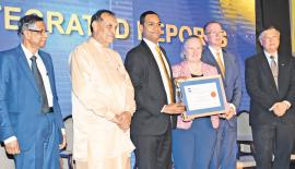 Deva Anthony, General Manager Finance of Mercantile Investments and Finance PLC, receives the CMA Top Ten Best Integrated Reports award from the Chief Guest, the Speaker of the Parliament, KaruJayasuriya and from Rachel Grimes, the President of The International Federation of Accountants, (IFAC). Also present is Prof. Lakshman Watawala, the President of CMA Sri Lanka, David McKinnon, Canada High Commissioner and Prof. Ho Yew Kee from Singapore Institute of Technology.