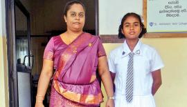 Sachini Dayaratne with her proud principal of St. Anthony's Girls School PRCK Ranasinghe