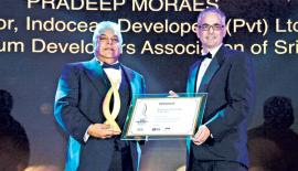 Altair Director Pradeep Moraes receives the Real Estate Personality of the Year Award from CEO, PropertyGuru Asia, Jeremy Williams.