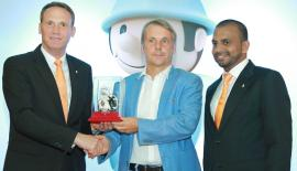 OBO Bettermann, Director of Sales and strategy for Sri Lanka, Middle-East and North Africa, Ralf Hennemann presents a token of appreciation to Ambassador Jörn Rohde while Hardi Jabir looks on.