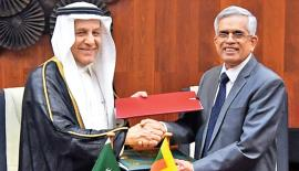Dr. R.H.S. Samaratunge and Yousef Ibrahim Al Abdulrahman Al Bassam exchange the agreement.