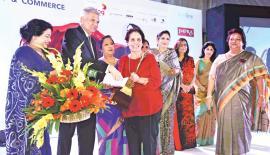 Aban Pestonjee receives the award from Prime Minister Ranil Wickremesinghe.
