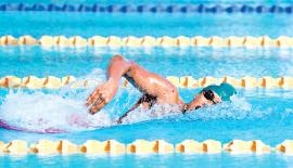Amrith Perera swims in the 200m Freestyle event