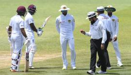 Sri Lanka captain Dinesh Chandimal with hands behind looks anxiously at umpire Aleem Dar's inspection of the ball during the concluded Test series against the West Indies in the Caribbean in this file photo