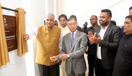 Prime Minister Ranil Wickremesinghe unveils the plaque to mark the  opening of the hotel.