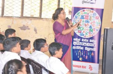 Deputy Director of the Telecom Regulatory Commission Mrs. Menaka Pathirana conducts the session in Sinhala for students of Central College, Kotahena.