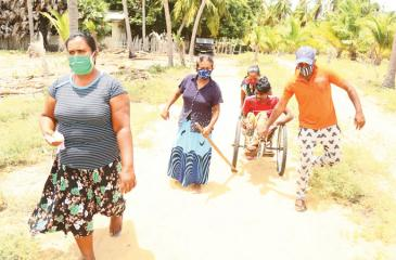 PUTTALAM: Kalpitiya voters on their way to cast their ballots at the Mohoththuwarama polling station. Pic by Prasad Poornimal, Puttalam Correspondent