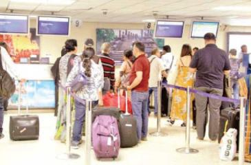Expat workers at check-in counters at the BIA