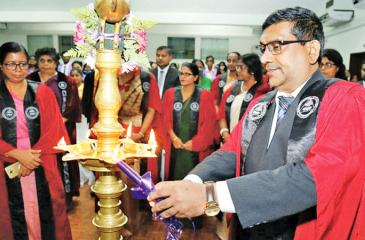 Newly elected Chairman Dr. Ruwan Gamage lights the oil lamp