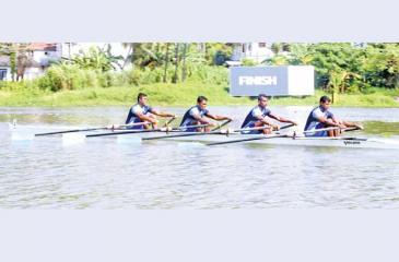 The champion Army team at last week's rowing nationals made up of Chinthaka, Senaratne, Bandara and Medonza on their way to the finish (Pix by Nirosh Batepola)