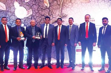The Kelani Cables team with the award