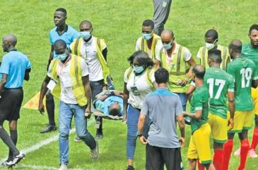 Ghanaian referee Charles Bulu who collapsed 80 minutes into a Group K match in Abidjan is taken to hospital on a stretcher