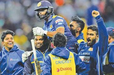 Asela Gunaratne is carried by Sri Lanka team-mates after he played a match winning innings against Australia in an ODI