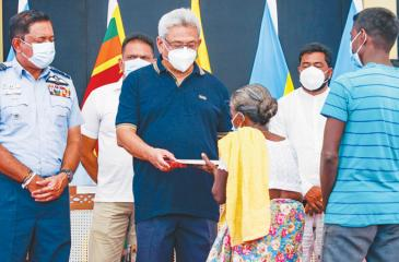 President Gotabaya Rajapaksa presents a gift to an elderly woman