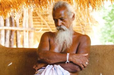 Veddha Chief Uruwarige Wannila-etto in his home at Kotabakiniya