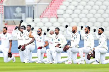 The West Indies players take a knee bow on the tour of England