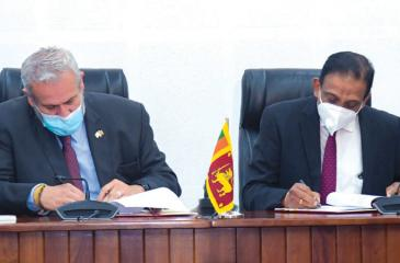 Secretary to the Ministry of Finance, Sajith Attygalle and World Bank Country Director for the Maldives, Nepal and Sri Lanka, Faris H. Hadad-Zervos sign the agreement.