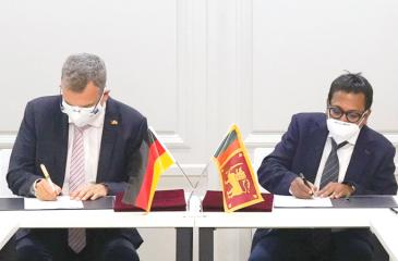 The signing of the MoU.