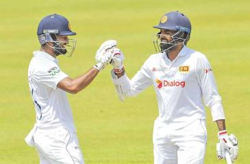 Dimuth Karunaratne (left) and Lahiru Thirimanne, both century-makers in the current second cricket Test against Bangladesh share a moment in Pallekele