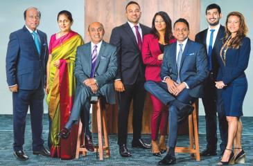 Standing (from left): Devaka Cooray, Mrs. Priyanthi Peris, Richard Gunawardene, Anika Wilson, Hussain Akbarally, Joyce Gunawardene. Seated: Chairman Siva Selliah and Managing Director Aelian Gunawardene.