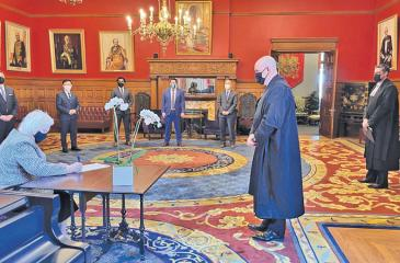 Lieutenant Governor of Ontario, Elizabeth Dowdeswell, signing the Royal Assent officially bringing the Bill into effect. (Courtesy: Tamil Guardian)