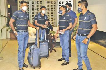 Sri Lankan players wait to leave their hotel in Colombo bound for England