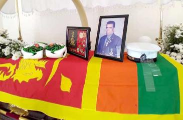 Boxing gloves placed on Sampath's casket on his final journey