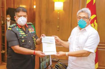 Gen. Shavendra Silva presents the cheque to President Gotabaya Rajapaksa
