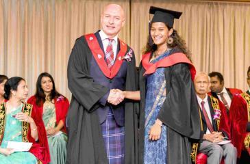 Vice-principal, International of the Edinburgh Napier University, Michael Greenhalgh congratulating the valedictorian of the class of 2019 Parami Pieris