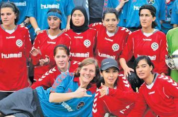 Members of the Afghanistan women's team at a a domestic match