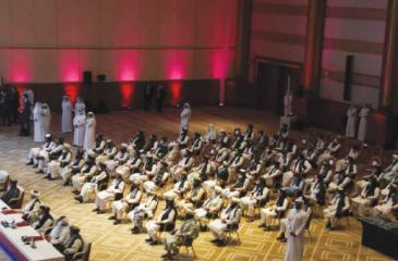 Taliban members attending the intra-Afghan peace