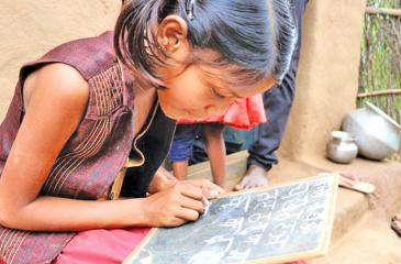 Radhika, 10, struggles to write the alphabet after 17 months of being out of school