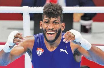 Andy Cruz of Cuba celebrates victory in Men's Lightweight (57-63kg)