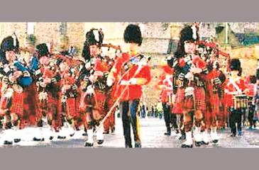 Bagpipers of the British Army playing at a military parade