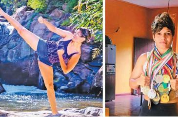 Dinusha gets a kick out of karate-Dinusha with her many medals