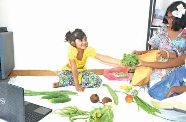 A little plays the role of a vegetable seller