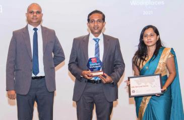 The CBL Natural Foods team with the award
