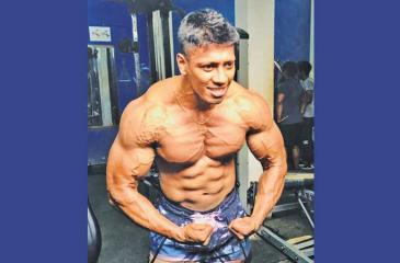 Incredible Hulk or Iron Mike Tyson.  Tharindu flexing his muscles like a bodybuilder
